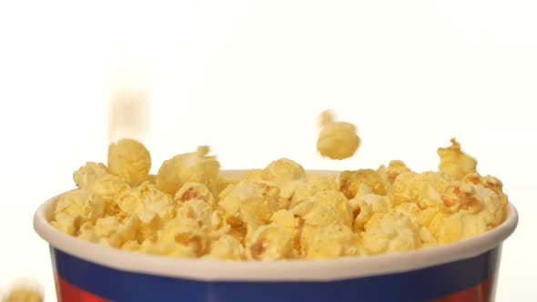 Thumbnail for Popcorn Falling in a Bag, on White, 2 Pack, Close Up, Slow Motion