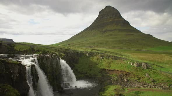 Thumbnail for Waterfall Cascades And Mountain Fresh Green Grass Famous Touristic Point In Iceland