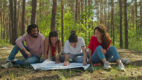 Eco Activists Drawing Ecological Poster Together