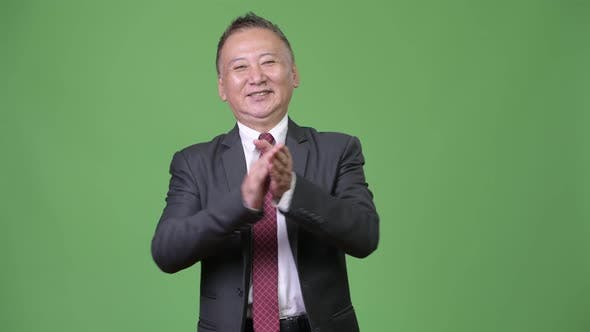 Thumbnail for Mature Happy Japanese Businessman Clapping Hands