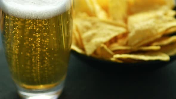 Thumbnail for Glass of Beer and Nacho Chips