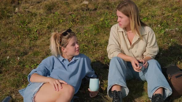 Teenager Girls are Resting at Nature