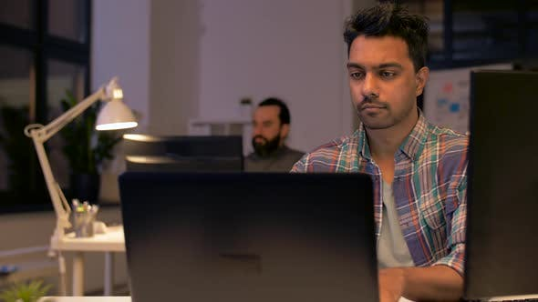 Thumbnail for Indian Man with Laptop Working at Night Office 41