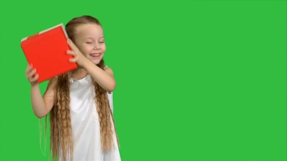 Thumbnail for Happy Smiling Girl Holding Gift Box on A Green Screen, Chroma Key