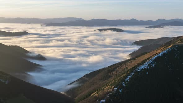 Thumbnail for Foggy Morning above Clouds in Mountains