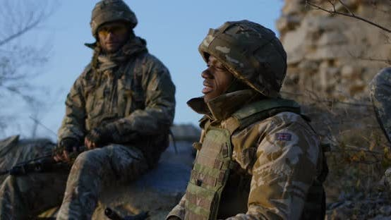 Thumbnail for Soldiers Sitting During a Break in an Assault