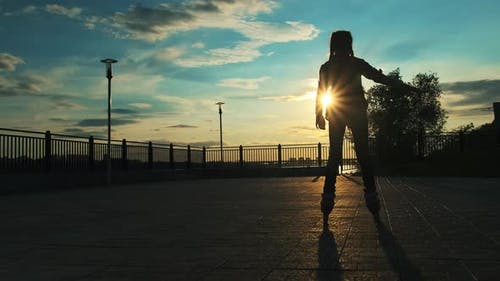 Girl Riding on Roller Skates