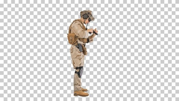 Thumbnail for Young man in military uniform checking revolver gun, Alpha Channel