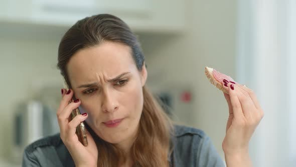 Thumbnail for Closeup Woman Getting Bad News. Rustrated Girl Talking Phone in Living Room.