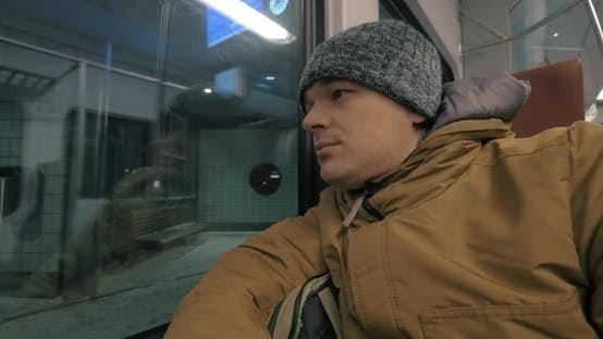 Commuter Train Ride in Winter Evening