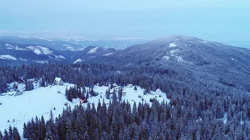 Winterland, Fly Over Mountains in Evening Sunlight