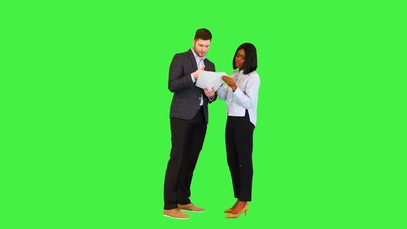 Businessman and Businesswoman Review Documents African Young Female Worker Explain Report to Boss on