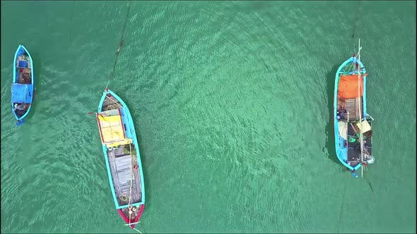 Thumbnail for Drone Removes From Close View of Fishing Boats To Ocean View