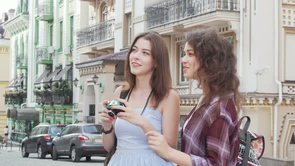 Thumbnail for Two Lovely Female Friends Taking Photos of the City While Travelling Together