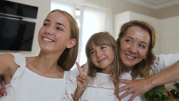 Thumbnail for Portrait of a Happy Family Who Makes a Selfie, Photographed on a Smartphone  in Kitchen