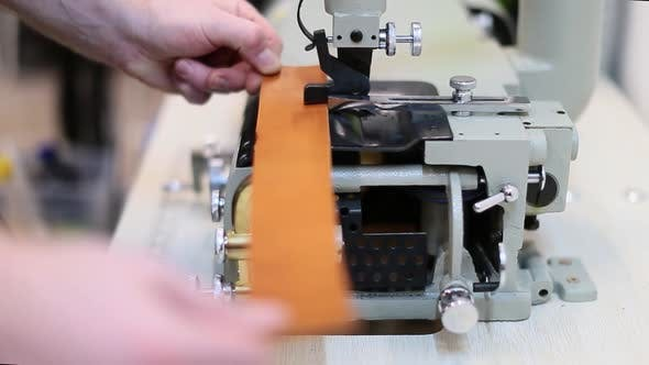 Thumbnail for Close Up View of a Process of Making Leather Craftwork. Worker Using Skiving Machine
