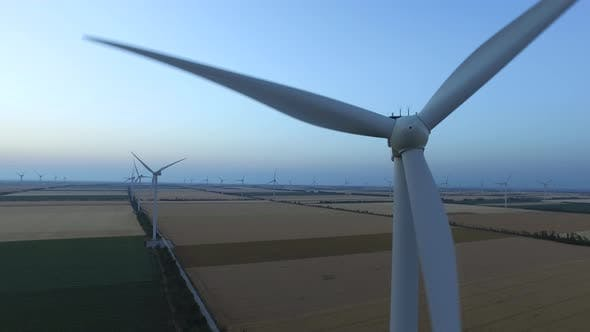 Thumbnail for Wind Turbines in Fields Near the Sea Driven with the Sea Breeze, Aerial Survey, Close Up