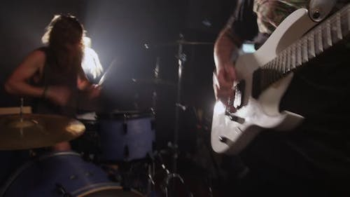 Guitar and Drums in heavy metal rock band