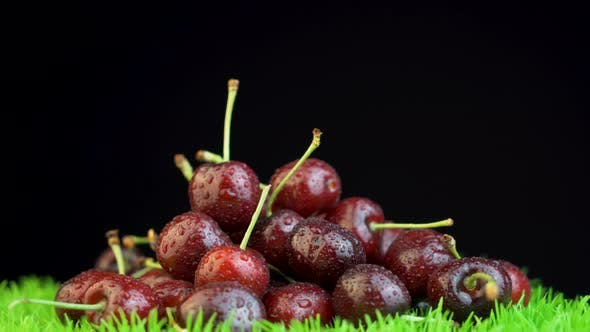 Thumbnail for Lots of cherries on rotating grass surface