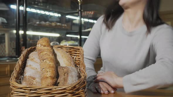 Happy Young Woman Smiling To the Camera After Smelling Aromatic Fresh Bread