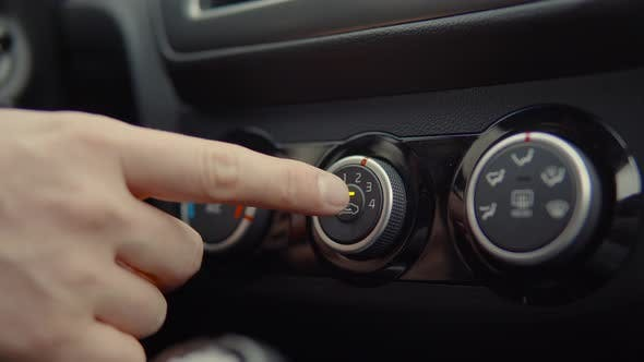 Man Starts the Car with a Button.