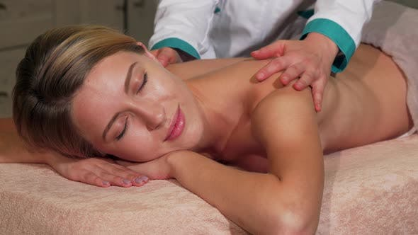 Thumbnail for Stunning Woman Smiling While Receiving Full Body Massage