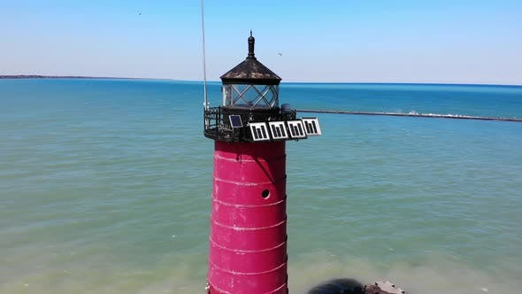 Red Lighthouse By the Sea on a Sunny Day. View From a Quadcopter on a Red Lighthouse.