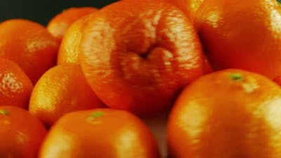 Macro Shot of Rotating Tangerines - Black Background
