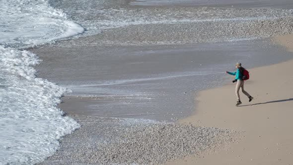 Thumbnail for Photographer Waves On Sand