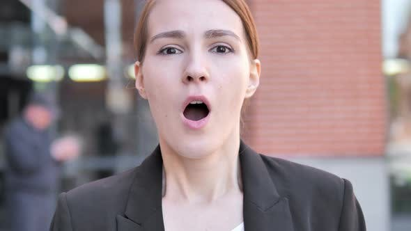 Outdoor Close up of Wondering Young Businesswoman