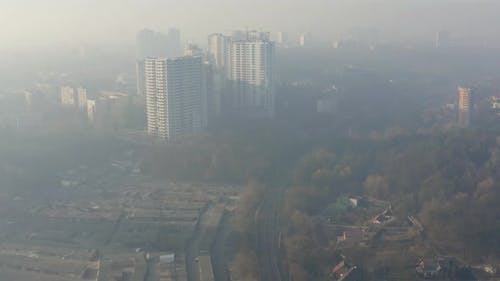 Aerial View of Smog or Fog Hanging Over the City. Air Environmental Pollution Concept