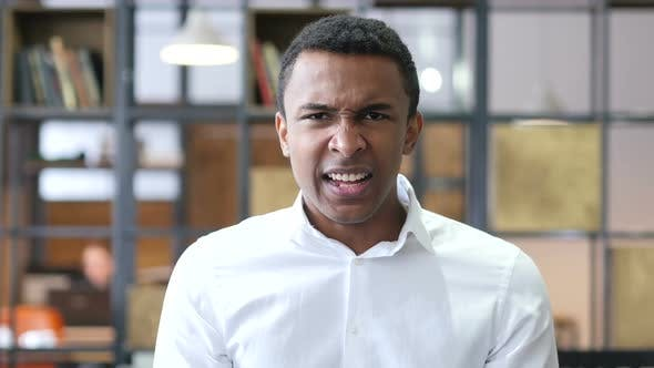 Cover Image for Black Man Screaming in Office