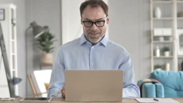 Thumbnail for Businessman Celebrating Success on Laptop