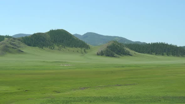Mongolian Ger Tent in Large Valley Plain of Mongolia Geography