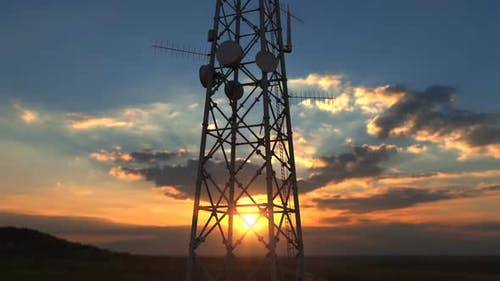 Flying Up Close To Telecommunication Tower Against Scenic Sunset