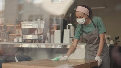 Mixed-race Waitress Cleaning Tables