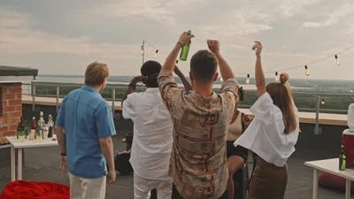 People Partying on Rooftop Terrace