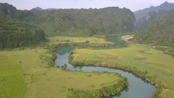 Thumbnail for Wonderful Tranquil Blue River Surrounded By Green Fields