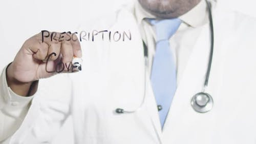 Asian Doctor Writes Prescription Coverage