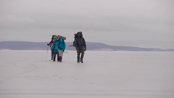 Thumbnail for Group of People Walking in Snow