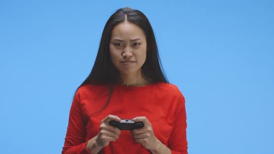 Young Woman Playing Video Game with Controller
