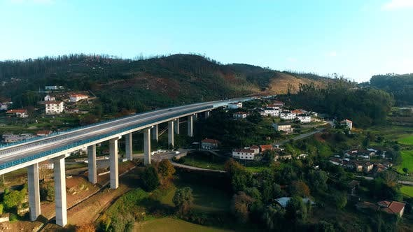 Thumbnail for Vehicles Passing Highway Bridge Aerial View