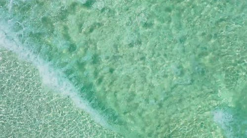 Beautiful overhead clean view of a white sand paradise beach and blue ocean background in colorful 4