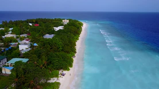 Thumbnail for Daytime overhead copy space shot of a white paradise beach and aqua blue water background in 4K