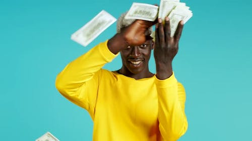African Man with Surprised Happy Face Scatters, Waste Money. Person Overspend US Currency. Guy in