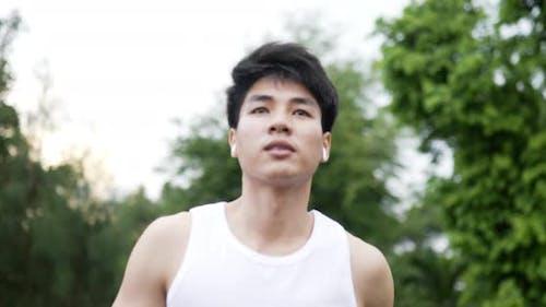 Fit asian man running