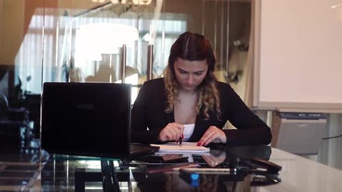 Business Woman Director Signs Documents That Bring to the Signature Secretary