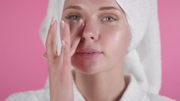 Thumbnail for Beautiful Woman Applying Lotion to her Face