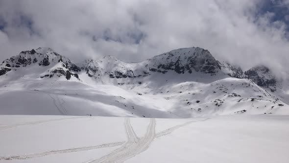 Thumbnail for High Altitude Rocky Snowy Dome Mountain Mass