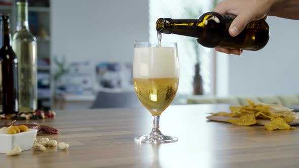 Pouring Beer In To Glass